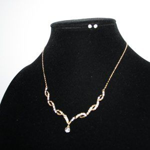 Gold and rhinestone necklace with stud earrings